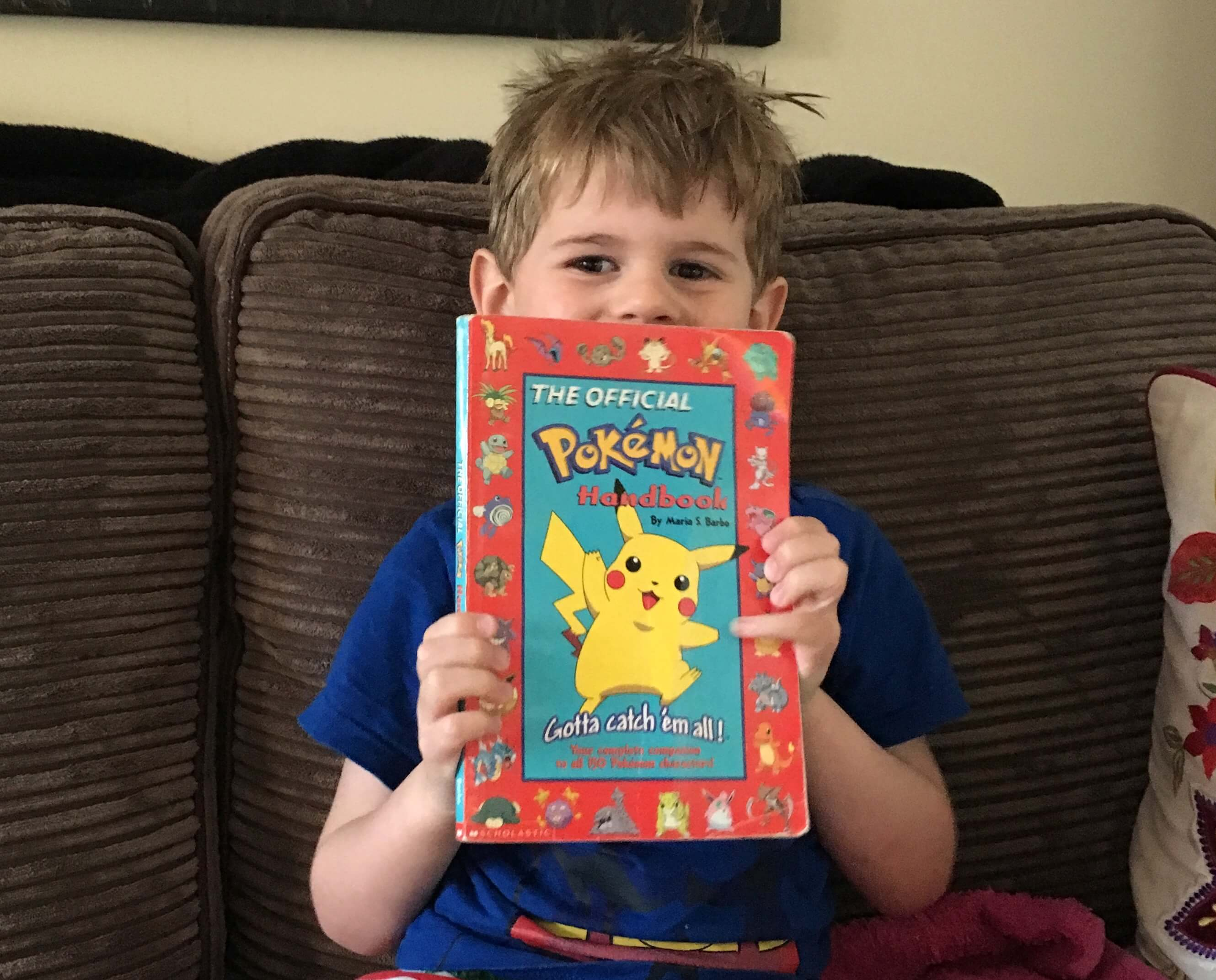 Ethan with my old Pokémon book